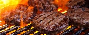 Hamburgers on outdoor grill